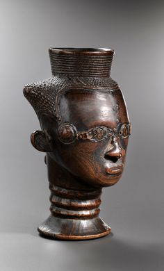 Africa | Palm wine cup from the Kuba people of DR Congo | Wood; orange brown patina | ca. 1st half of the 20th century