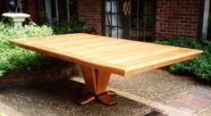 Custom Dining Table in Cherry with black inlays    Opens to seat 10.   Exceptional !