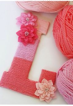 So cute!! Just get a wooden letter, yarn color of your choice and some fake flowers and there you go!