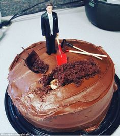 Mud cake grave: One groom cake topper was burying his wife in a cake grave...