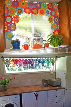 A flower crochet valance will enhance the look of your kitchen window. - Top 20 Cutest Crochet Projects Help to Personalize Your Home