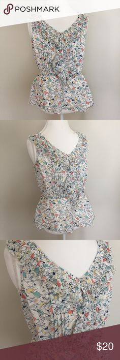 """Lauren Conrad LC Bird Print Ruffle Top LC Lauren Conrad pretty bird Print Top with Ruffle detail. Size large. Excellent condition with no flaws. Made of 100% polyester. Approximate measurements flat and unstretched: pit to pit 18"""", total length 23"""". ⚓️ No trades or holds. I do accept reasonable offers and offer a bundle discount. I only negotiate through the offer button. 🚭🐩T4 LC Lauren Conrad Tops Blouses"""