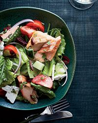 Greek Salad with Oregano-Roasted Salmon Recipe on Food & Wine : People think a Greek salad is mostly vegetables and cheese, but by adding simply roasted salmon, it becomes a terrific main course.