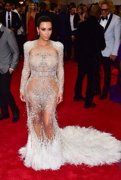 "Kim Kardashian's Best Red Carpet Dresses of 2015 - The ""naked dress"" designed by Peter Dundas for Roberto Cavalli, worn at the Met Gala"