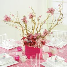 Chic modern twist on the typical pink orchid and branches centerpiece for your wedding.
