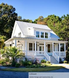Love this house. I love the wrap around porch, I would have hanging plants around and hummingbird feeders and a huge rocking chair :)