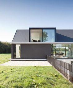 modern-barn-style-home-showcases-glazings-below-grade-ramp-4-dining.jpg