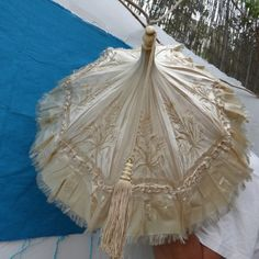 Lovely antique parasol with finely hand carved bone handle with motifs of leaves, topped with finial with original tassel present. The shade is in beige satin with hand embroidered flowers and leaves, interior in silk Embroidered Silk, Embroidered Flowers, Costume Accessories, Vintage Accessories, Victorian Fashion, Vintage Fashion, Women's Fashion, All Black Dresses, Vintage Cigarette Case