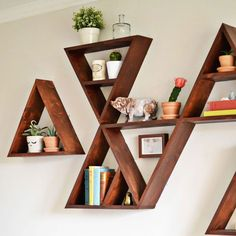 Interior inspo! We love these wooden triangle shelves found on whimsydarling.com. #lovekas