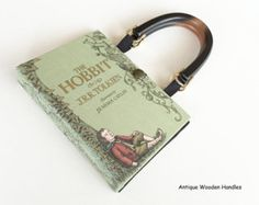 www.NovelCreations.etsy.com  > > > SWIPE through and TAP ON photos to see all the selections.< < <  ❖ This actual book Lord of The Rings has been recycled into a stunning occasion handbag.  ❖ The red leather bound book is stamped gold, red, and blue accents that really makes the cover pop..  ❖ Covered with a clear protective book cover to make it durable and easy to wipe clean.   Details:  ❖ Your purse measures 9 inches by 6 inches with a generous 3 inch spine, roomy enough.  ❖ Inside pages…
