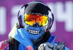 Course worker Svyatoslav Shirvel wears headphones and goggles during slopestyle snowboard training at the 2014 Winter Olympic Games Mike Blake Reuters blue bandana Dia de los Muertos #snowboarding #goggles #eyes #sun #winter #snow #ski #board