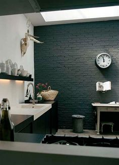 Black + white kitchen .... very dramatic. Do we go for darker paint on the chimney breast? Dark teal or navy or even black to go with work tops?!!