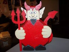 Devil halloween decoration made of concrete and wood. $25.00. Further inquiries, pso4112000@yahoo.com