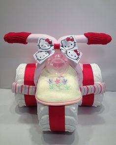 Kitty cat diaper cake http://babyfavorsandgifts.com/diaper-cakes-baby-girl-c-3_22.html