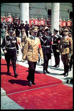 1939  Hitler gets the red carpet treatment when he attends the Day of German Art  flanked by his elite Leibstandarte-SS Adolf Hitler bodyguards. Max Wunsche was in black SS uniform at his left hand side following him.