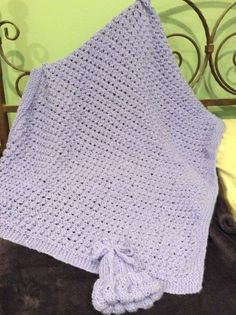 I found this beautiful pattern free on Pinterest. It's called Knit Baby Blanket on Yarn Lover's Room.  The hat is a very simple pattern found at Sorella and Company.