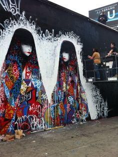 The artist who goes by the name of Hush is a prolific street artist who has taken to fine art as well. His work depicts geishas with generally high contrast images that layer up graffiti to create complex patterns. A lot of the work relies on a palette comprised of primary colors.