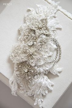 An antique silver and beaded lace wedding hair comb