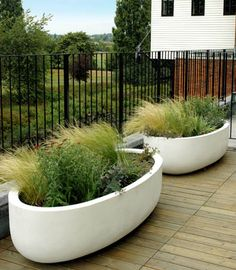 Urbis Lagoon planters - these would make a phenomenal mini pond on a deck or patio, love the style and form!