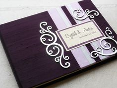 Eggplant and Lilac Wedding Guest Book with Swirl Embellishments (made to order). $47.00, via Etsy.