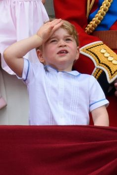 Prince George of Cambridge watches a fly past during the Trooping the Colour, this year marking the Queen's 90th birthday at The Mall on June 11, 2016 in London