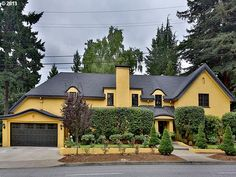 Bright Yellow! Topped with a charcoal Story-book curved roof, perked up by the bright green foliage... :)