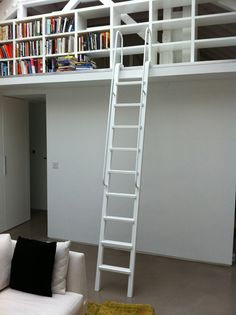 mm-furniture - mezzanine, library ladder with two handrails sprayed in white.