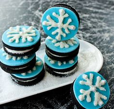 Snowflake cookies - Make special snowflake inspired cookies. Design the exterior of the cookies with pretty snowflake drawings and stack them up on your coffee table for design and consumption.