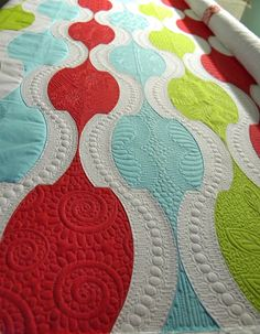 Sew Kind Of Wonderful: Urban Holiday ~ Blogger's Quilt Festival    Amazing use of quilting patterns.  I love the lines of circles down the white stripes.