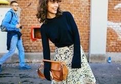 Irina Lakicevic in a Celine skirt and with a Loewe bag. | Street Style | MFW SS 2016 | Photo: Phil Oh | Source: vogue.com