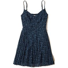 Hollister Ruffle Skater Dress (98 BRL) ❤ liked on Polyvore featuring dresses, navy print, circle skirts, v-neck skater dresses, v neck skater dress, navy blue skater dress and blue skater dress