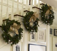 I love these wreaths hanging on the stair tread wall! I might be able to pull this off if I only put 2 or 3 and then a few more on the landing rail! Oh ya!