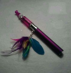 Hippie feather vape charm created by Beadiccan Jewelry.
