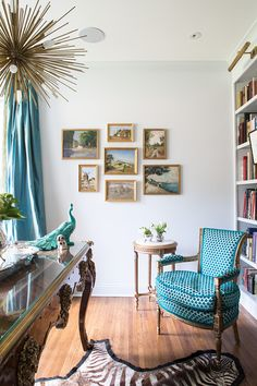 Gallery wall, landscapes, similar gold frames. House of Turquoise: Jenna Wallis Interior Design