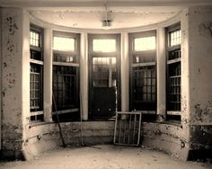 Curving windows on a ward floor. Patients could sit here and have a slightly expanded view of the outside world which was forbidden to them.