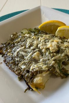 """Baked Tilapia with Arugula and Pecan Pesto 