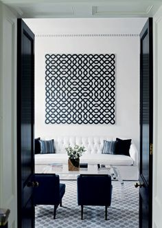 black and white living room with an art focal piece!