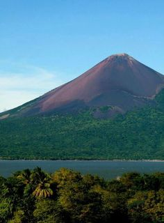 Momotombo Volcano, Leon, Nicaragua. Momotombo is a stratovolcano not far from the city of León. It stands on the shores of Lago de Managua. An eruption of the volcano in 1610 forced inhabitants of the Spanish city of León to relocate about 30 miles west.