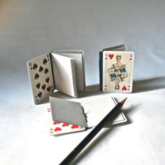 Small Blank Books from Repurposed Playing Cards featuring Henry VIII Queen Victoria and Disraeli. $15,00, via Etsy.