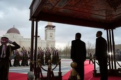 President Obama and King Abdullah II stand at the dais as the honor guard is dismissed during the official arrival ceremony at Al-Hummar Palace in Amman, Jordan, March 22, 2013.