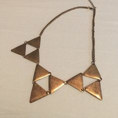 """EDGY NECKLACE This gold, triangular designed necklace adds edge and style to any outfit! Chain is 10"""" (not including the front) +3"""" extension. Never been worn. PacSun Jewelry Necklaces"""