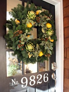 Artichoke and lemons add beauty to this wreath! stylish patina, interior design, christmas decor#christmasdecals #christmasdecor