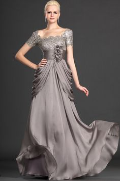silver lace , flower decorated, elegant drapes.....How can I not buy it for my dear mother