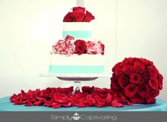 Tiffany blue and red roses cake decor - I like the rose petals under the cake stand.