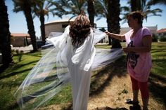 Israeli bride Ziva Mordechai arrives for her wedding to Haim Zohan in a bomb shelter of a Yeshiva (religious school) in the southern Israeli city of Sderot on July 16, 2014. (Menahem Kahana/AFP/Getty Images)