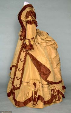 SILK FAILLE BUSTLE DRESS, 1868-1872 3-piece cocoa brown & chestnut brown: peplum bodice, bell skirt & bustle overskirt, trimmed w/ ruffles, small & large functional & decorative buttons embroidered w/ stars, ruched bands & fringed bows, muslin bodice lining, glazed cotton & buckram skirt lining, B 35, W 23.5, (1 large skirt button missing, few seam areas unstitched, some ruched bands missing & unstitched, few small splits in bustle overskirt