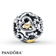 Smooth and beaded outlined sterling silver hearts frame smaller 14K yellow gold hearts in this Spread the Love charm from the PANDORA Winter 2014 collection. The charm is exclusively available from Jared® the Galleria of Jewelry. Style # 791372.