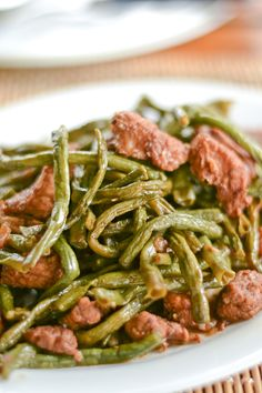 String Beans Adobo (Adobong Sitaw) is a popular Filipino dish using string beans and pork belly. String beans and pork pieces are simmered in a sauce consisting of soy sauce and vinegar. Filipino Dishes, Filipino Recipes, Asian Recipes, Filipino Food, Oriental Recipes, Asian Foods, Yummy Vegetable Recipes, Vegetable Dishes, Vegetarian Recipes