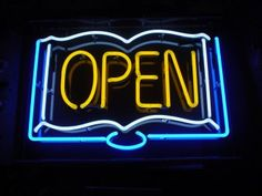 """A neon """"Open"""" sign from a limited series of signs made for Pegasus and Pendragon Bookstores in Oakland and Berkeley, California."""