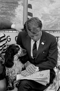 Bobby Kennedy and Freckles read the newspaper
